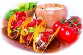 foto of tacos  - Mexican tacos in tortilla shells with fresh vegetables - JPG