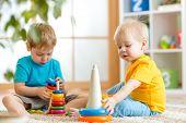 stock photo of child development  - children boys with educational toy in nursery - JPG