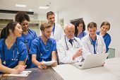foto of medical  - Medical students and professor using laptop at the university - JPG