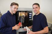 stock photo of mechanical engineering  - Engineering students using 3d printer at the university - JPG