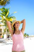 picture of playa del carmen  - Relaxed cheerful woman enjoying tropical caribbean vacation at the beach in Playa del Carmen Riviera Maya Mexico - JPG