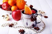 picture of christmas spices  - Metal mug of mulled wine fruits - JPG