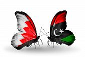 foto of libya  - Two butterflies with flags on wings as symbol of relations Bahrain and Libya - JPG