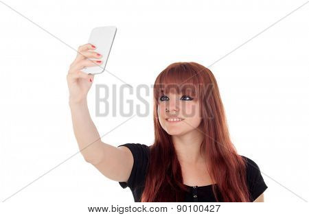 Teenage girl dressed in black getting a photo with the mobile isolated on white background