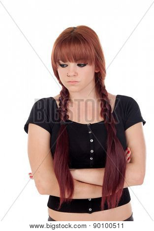 Angry teenage girl dressed in black with a piercing isolated on white background
