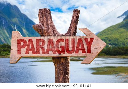 Paraguay wooden sign with mountains background