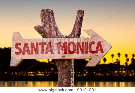 Santa Monica wooden sign with sunset background