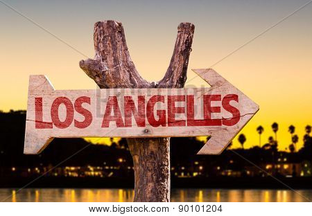 Los Angeles wooden sign with sunset background