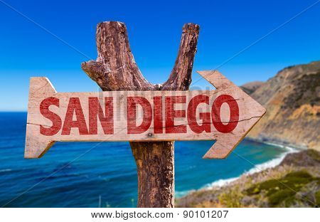 San Diego wooden sign with coast background