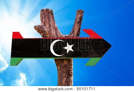 Libya Flag wooden sign with sky background