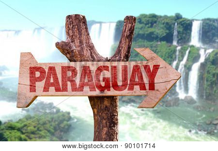 Paraguay wooden sign with Igua�?�§u Falls on background