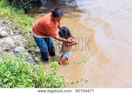 Yasuni, Ecuador - 17 November 2012: Indigenous Family, Mother And Daughter, Bath Time In Amazon River, South America In Yasuni On November 17, 2012