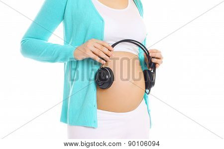 Pregnant Woman And Headphones