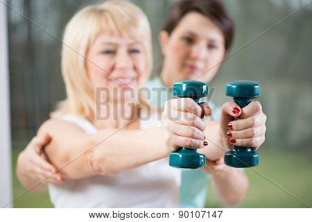 Female Training With Dumbbells
