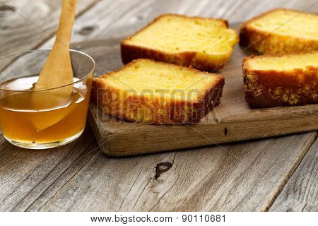 Fresh Slices Of Lemon Cake And Honey On Wood Server