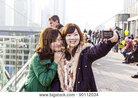 Japanese Tourists Take Self-portraits
