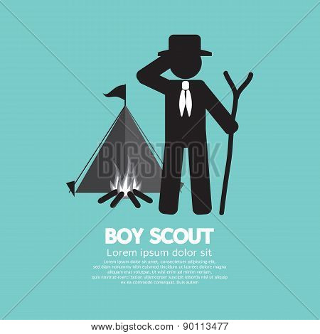 Boy Scout Standing In Front Of Tent And Bonfire.