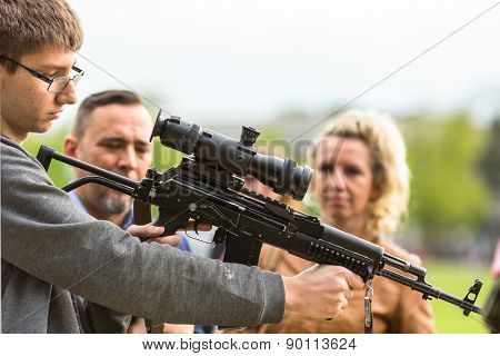 KRAKOW, POLAND - MAY 3, 2015: Unidentified people during demonstration of the military and rescue equipment  in framework Polish national and public holiday the Constitution Day May 3rd.