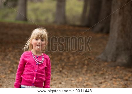 Little Girl Enjoying A Lolly Pop.