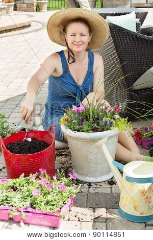 Smiling Lady Gardener Potting Up Spring Flowers