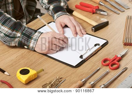 Man Sketching A Diy Project On Paper