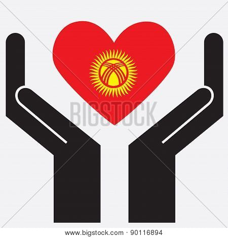 Hand showing Kyrgyzstan flag in a heart shape.