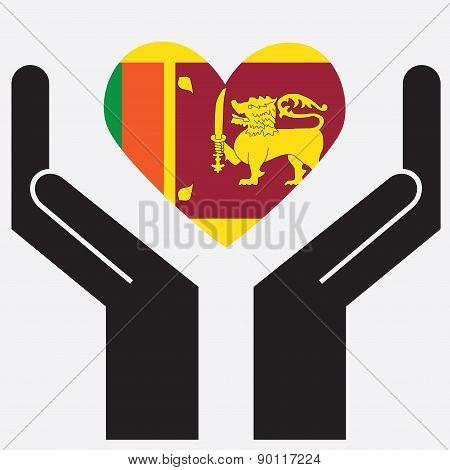 Hand showing Sri lanka flag in a heart shape.