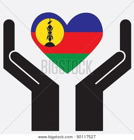 Hand showing New Caledonia flag in a heart shape.