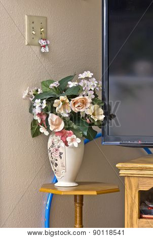 Still Life Plastic Flowes Tv And Stand.