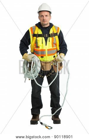The man in a worker uniform and with building tools
