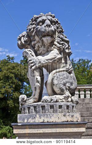 MUNICH, GERMANY - JUNE 8, 2011: lion in park of nymphenburg castle munich