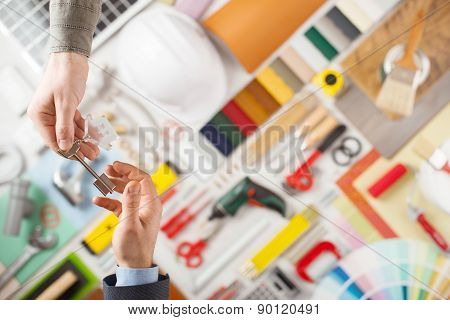 Constructor Handing Keys To The House Owner
