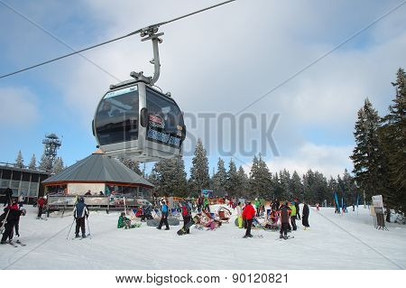 Cable Car, Restaurant And Skiers.