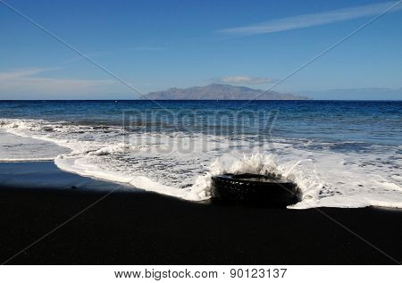 Waves Smash Into Tire