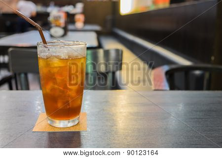 Glass Of Iced Lemon Tea On Table
