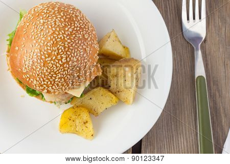 Cheeseburger With Turkey And Potato wedges Top View