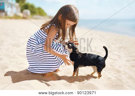 Little Girl And Dog On The Beach In Sunny Summer Day Near Sea, Child With Puppy Outdoors