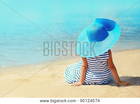 Summer, Vacation, Travel And People Concept - Pretty Little Girl In Striped Dress And Straw Hat Enjo