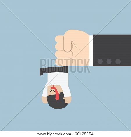 Businessman Hanging From Upside Down By A Big Hand