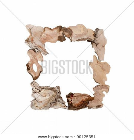 The original frame of pieces of tree bark isolated on white.