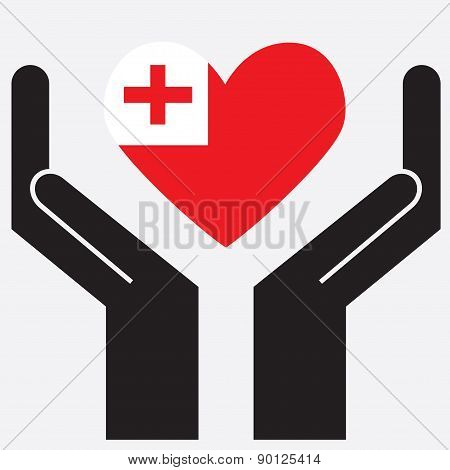 Hand showing Tonga flag in a heart shape.