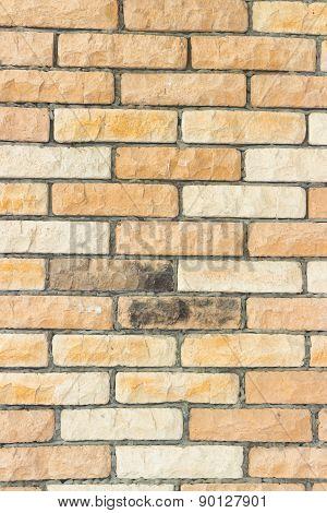 Brick wall of red and orange brick