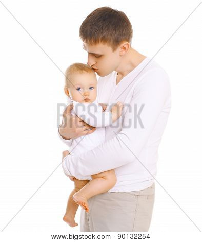Happy Young Father Holding On Hands And Kissing Baby