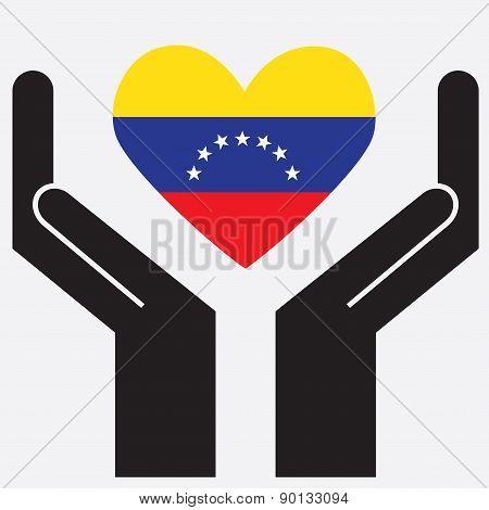Hand showing Venezuela flag in a heart shape.