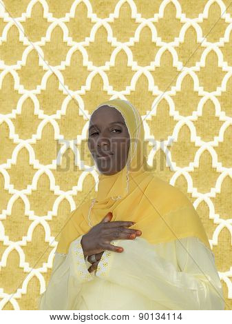 African woman wearing a yellow cotton veil