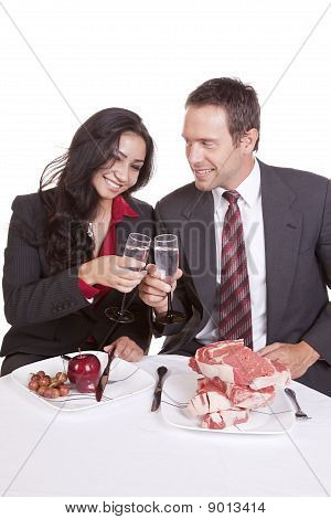 Couple Cheers Steak And Fruit