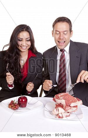 Couple With Steak And Fruit