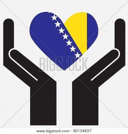 Hand showing Bosnia and Herzegovina flag in a heart shape.