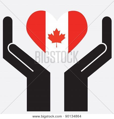 Hand showing Canada flag in a heart shape.