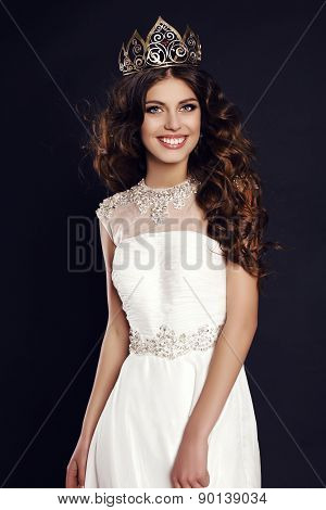 Gorgeous Young Woman With Luxurious Hair Wearing Crown Of Beauty Contest